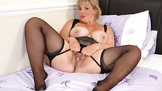 Hot milf Danielle lets her clit grow and glow with a sex toy