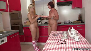 Lesbian blonde teen and mom toying on kitchen